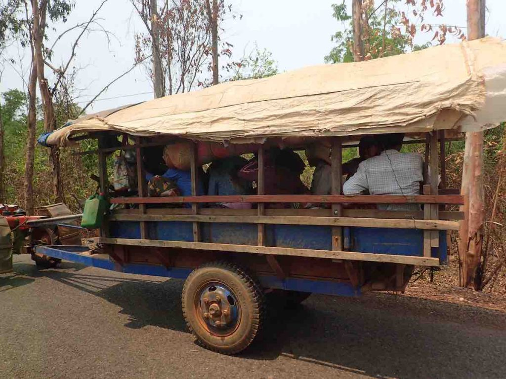 picture of dusty cart crammed with people