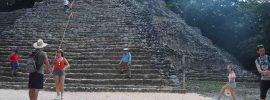 The Mayan site of Coba, with the author standing near the bottom of the large pyramid there