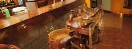 Picture of bar stools with horse saddles as seats