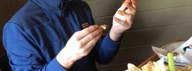 Nephew eating chicken wings at Hooters
